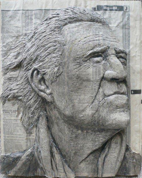 Escultura com lista telefônica